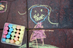 Child's chalk drawing. A chalk drawing done by a child on patio pavers Royalty Free Stock Photos