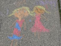 Chalk drawing. A child`s chalk drawing on a summers day stock photo