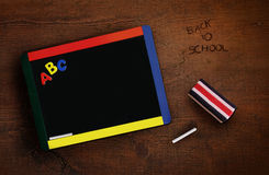 Child's chalkboard with eraser on desk Royalty Free Stock Photography