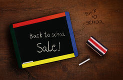 Child's chalkboard with eraser on desk Stock Image