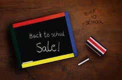 Child's chalkboard with eraser on desk Stock Image