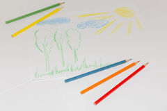 Child`s color drawing on a white paper with color pencils.  royalty free stock photography