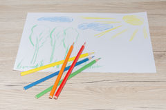 Child`s color drawing on a white paper with color pencils.  royalty free stock photos