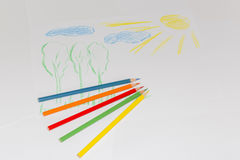 Child`s color drawing on a white paper with color pencils.  stock images