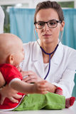Child's doctor auscultating baby Stock Photography
