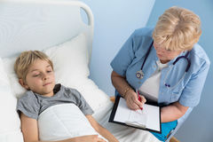 Child's doctor talking with ill patient Stock Photo