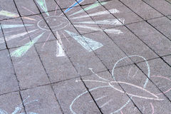 Child's drawing. On asphalt. Sun and butterfly royalty free stock photo