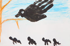 Child`s drawing of big black bird on tree Royalty Free Stock Image