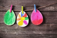 Child`s drawing of Easter eggs on wooden background. The child`s drawing of Easter eggs on wooden background royalty free stock image