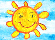 Child's drawing of a funny sun over blue sky Royalty Free Stock Image