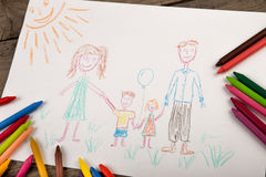 Child`s drawing of a happy family stock photos