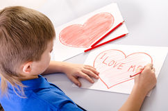 Child's drawing a heart that says I love mom Stock Photography
