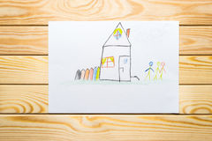 Child`s drawing. home happy family. wooden background. Child`s drawing. home and happy family wooden background Stock Image