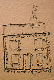 Child's drawing of a house. In the sand Royalty Free Stock Images