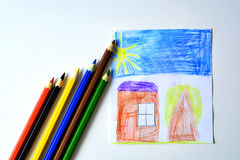 A child`s drawing of a house with colored pencils. A child`s drawing of house, tree and sky colored pencils royalty free stock images