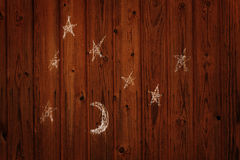 Child's drawing of the moon and stars on the wall Royalty Free Stock Photography