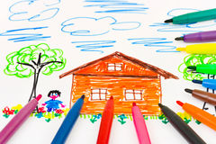 Child's drawing and pens Royalty Free Stock Photography