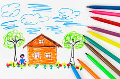 Child's drawing and pens Royalty Free Stock Photos