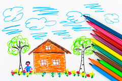 Child's drawing and pens Stock Images