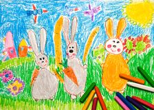 Child's Drawing of rabbits family. Under the blue sky Stock Photo