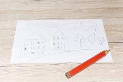 Child`s drawing with a simple pencil on a white sheet of paper. Child`s drawing with a simple pencil on a white sheet of paper Stock Photo