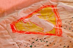 A child`s drawing of a superhero sign.  stock photography
