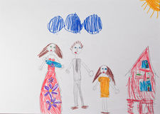 A child`s drawing which depicts a happy family with children. A child`s drawing which depicts a family with two parents and children and a country house Royalty Free Stock Photo