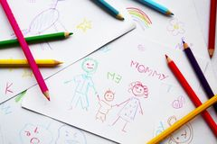 Child's drawings and colored pencils Royalty Free Stock Image