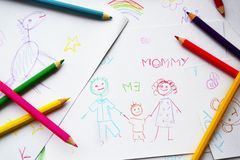 Child's drawings and colored pencils Royalty Free Stock Images