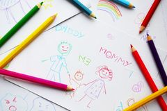 Child's drawings and colored pencils Stock Images