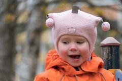 Child`s emotion on the playground in autumn day stock photography