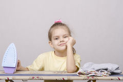 The child's exhausted ironed linen Royalty Free Stock Images