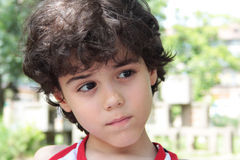 Child' s expression. Close portrait of an attractive boy Stock Photo