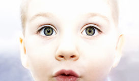 Child`s eyes. The child`s eyes, expressed surprise, light background Stock Photo