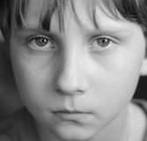 The child's eyes, serious looking Stock Images