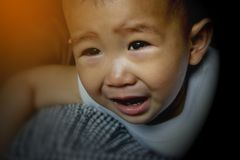 The child`s face is crying. Royalty Free Stock Photos