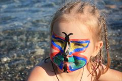 Child's face painted as butterfly Royalty Free Stock Images
