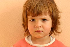 Child's faces. Portrait of a child with sad face Royalty Free Stock Photo