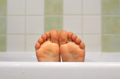 Child's feet. On the bathtub Royalty Free Stock Images