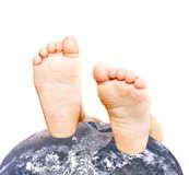 Child's feet on globe Royalty Free Stock Image