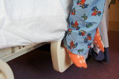 Child's Feet on Hospital Bed Royalty Free Stock Photography