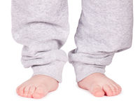 Child's feet isolated on white Stock Images