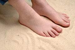 a child's feet in the sand Royalty Free Stock Photo
