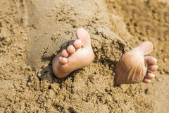 Child's feet in the sand Royalty Free Stock Photo