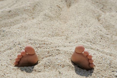 Child's feet in the sand close-up Royalty Free Stock Image