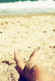Child's feet in the sand. filtered image Royalty Free Stock Photo