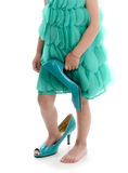 Child`s feet in shoes with heels Royalty Free Stock Photography