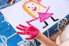 Child& x27; s-Fingermalerei Stockfotos