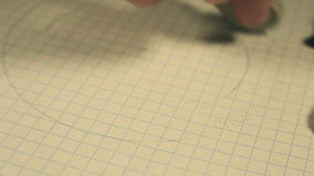 Child's fingers erase the gray lines on a paper stock video footage
