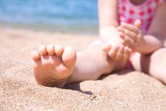 Child's foot is close to the beach Royalty Free Stock Image